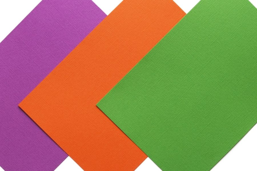 orange, green and violet colours of textured canvas papers