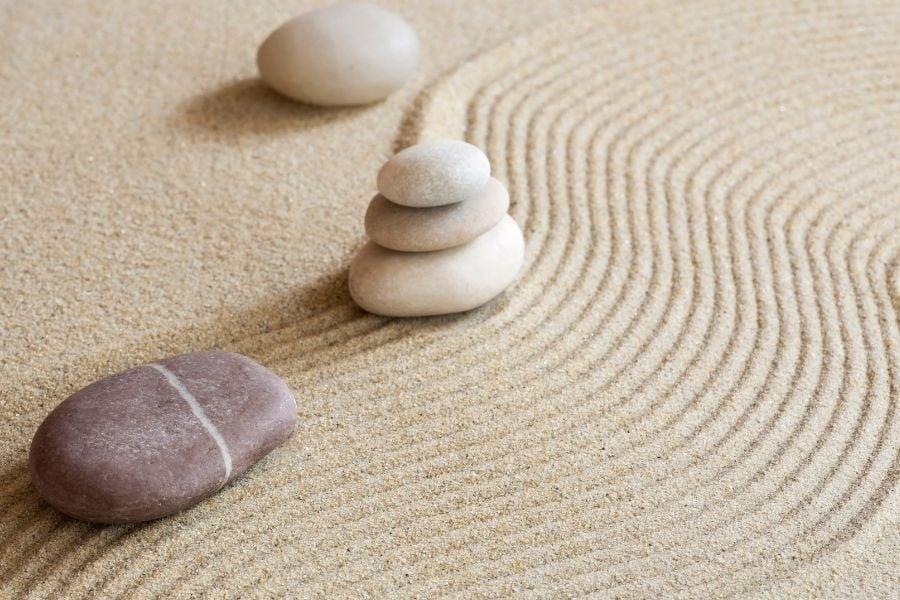 Miniature Zen Garden with rocks and sand pattern