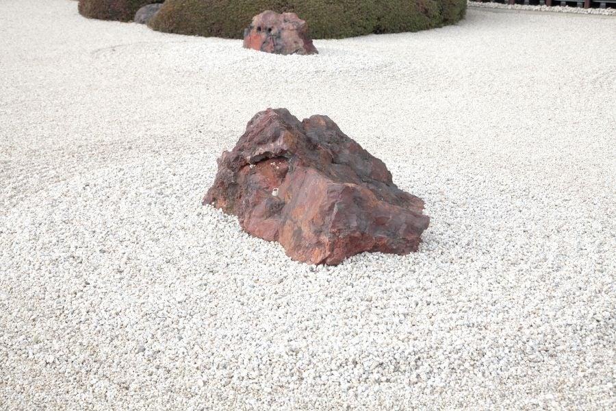 a zen garden corner with rock decorative